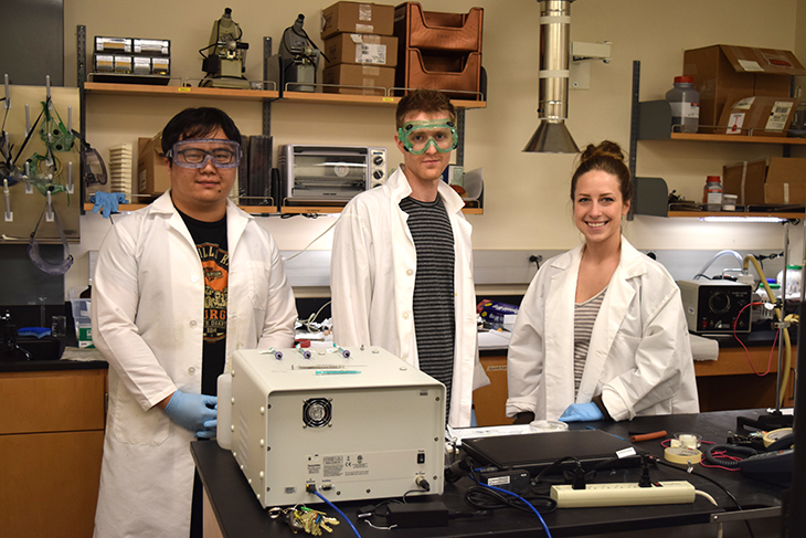 Green River College engineering students participate in a lab developing solar cells.