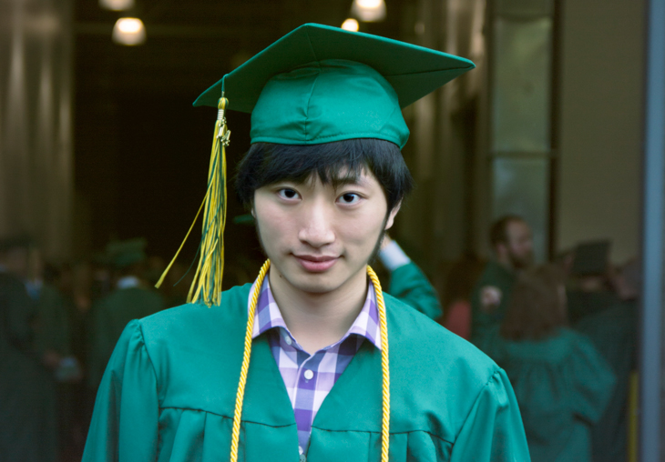 Yanwei Yang in Green River cap and gown.