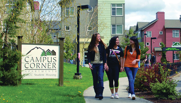 Photo of students walking in front of Campus Corner Apartments