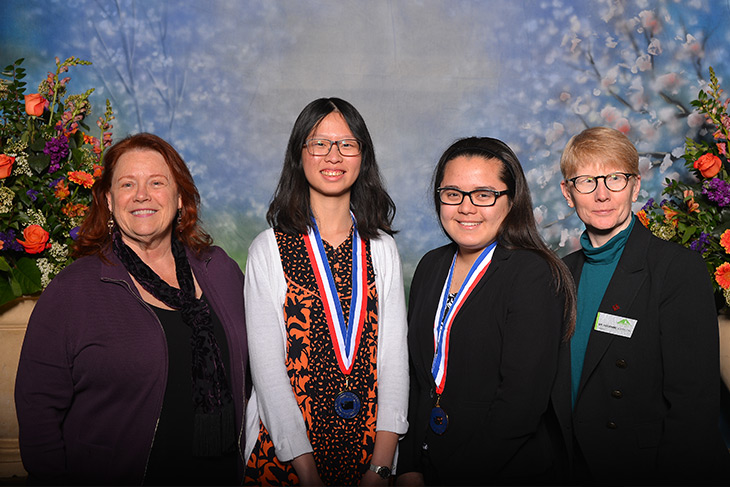Photo of Trustee Jackie Boschock, President Suzanne Johnson and All Washington Academic Team scholars Sharon Gozali and Anna Matsumoto
