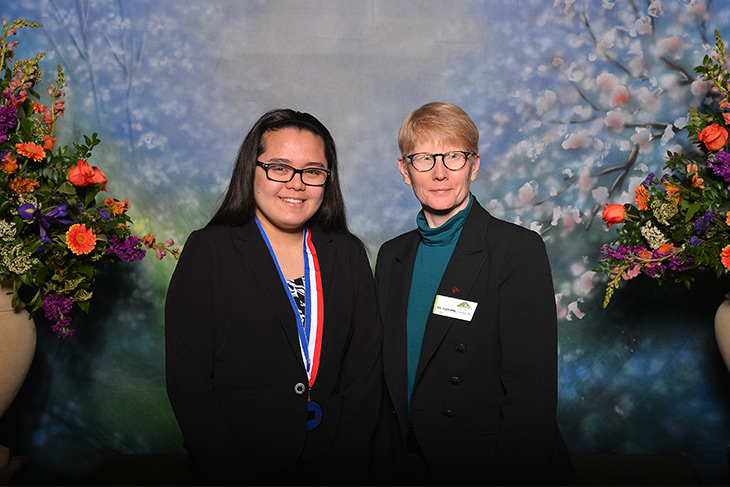 Photo of President Suzanne Johnson and ll Washington Academic Team scholar Sharon Gozali
