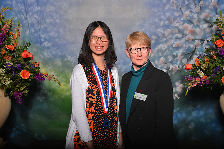 Photo of President Suzanne Johnson and ll Washington Academic Team scholar  Anna Matsumoto