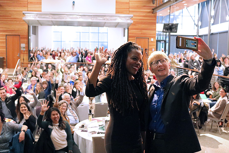 GRC President Johnson and keynote speaker C. Nicole Mason take a selfie at opening day