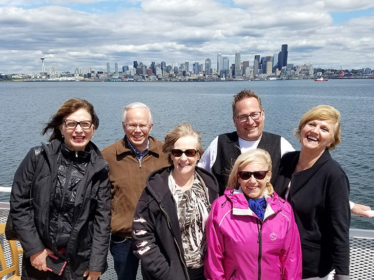 photo of Prime Time members in front of the Seattle, Washington, city skyline