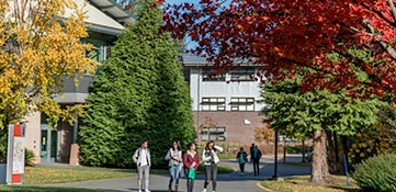 Green River College campus pathways and students in the fall season.