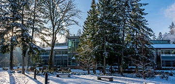 Green River College campus in the winter season with snow on the ground.
