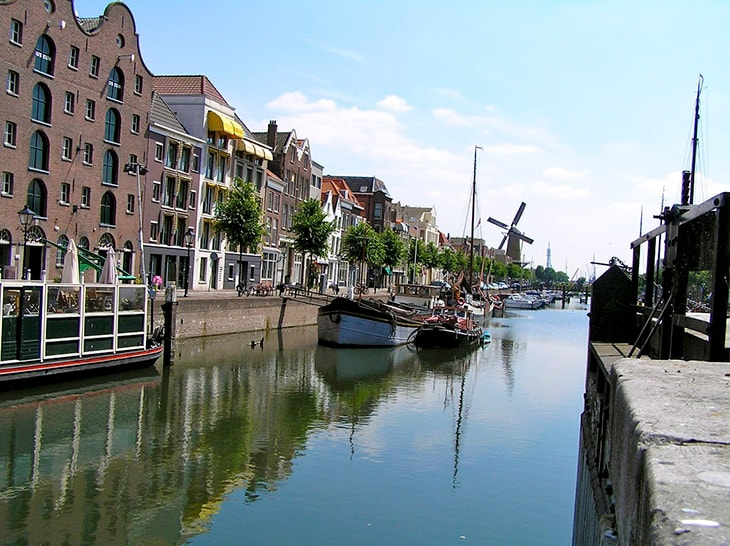 photo of a waterway with boats and buildings