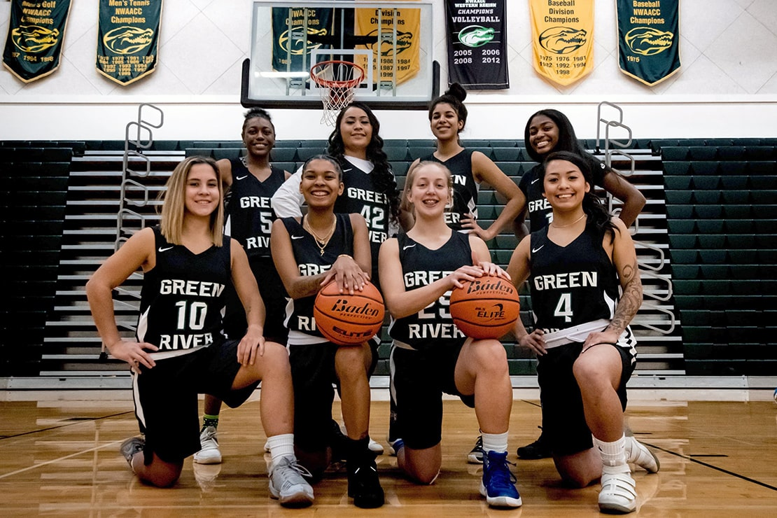 The 2018 Green River College women's basketball team posing in uniform for a team photo.